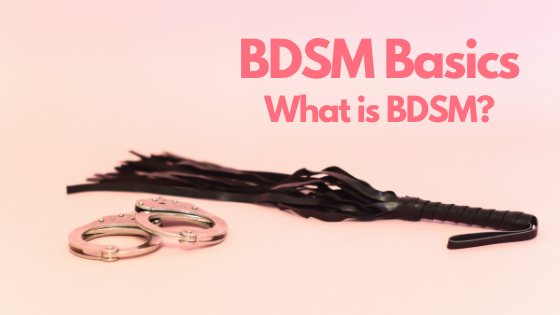 A pair of handcuffs and black flogger lay on a pink background. The text is BDSM Basics: What is BDSM?